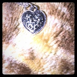 Ladies silver colored necklace with heart pendant